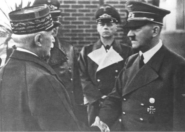 "Petain's the guy on the left and, oh yeah, the guy he's shaking hands with is freaking Hitler.  (I know I usually have a rule to not mention the ""H word"" but this is to prove a point.) This guy kept wanted to have meetings with the Big H, but Hitler didn't even care enough to respond."